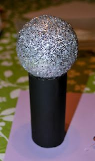 Play microphones from Styrofoam balls, glitter and toilet paper rolls.