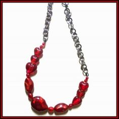 red glass beads and silver chain necklace