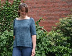 Dalyla is knit slightly loosely from the top down in one piece. It features a wide neck, cable details, aline shaping and the back is worked longer than the front. The drape and shaping make for a lovely lightweight flowing pullover.