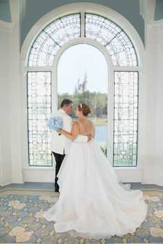 Disney Fairy Tale Wedding ceremony and portraits in Disney's Wedding Pavilion with a view of Cinderella's Castle