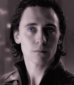 Loki -- The shadows and light playing on his face, the rain on his hair, the blue in his eyes..
