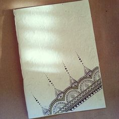 Diy notebook in rice paper. Zentangle illustration. Indian inspiration.