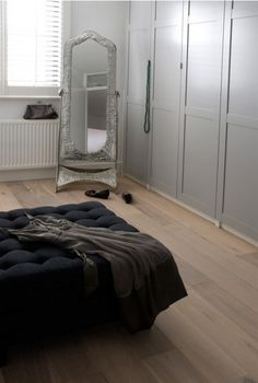 built-in wardrobe. Love the shade of grey and the flooring in this gorgeous bedroom