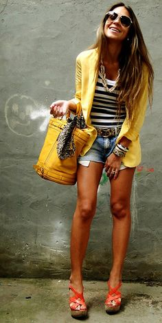 The yellow blazer is a great pop of color and added layer, along with her jewelry
