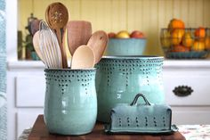 The perfect crock for your cooking tools... This beautiful kitchen crock can hold 10 or more utensils. It is hand designed with a special slip trailing technique and glazed in Aqua Mist. The texture beautifully breaks through the glaze to reveal the design.