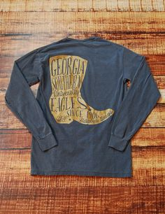 Boot scootin' boogie in this awesome new Georgia Southern University long-sleeve t-shirt! You know you wanna look super cute in this tee! Go Eagles!