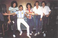 Queen posing with Maradona.