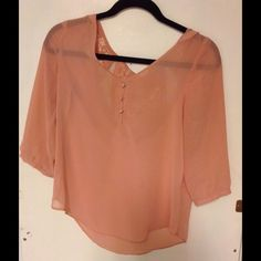Dusty Pink Blouse Gorgeous dusty pink blouse. Worn a few times and is so cute. The back has lace around the neck and shoulders. So pretty. Size medium. Tops Blouses