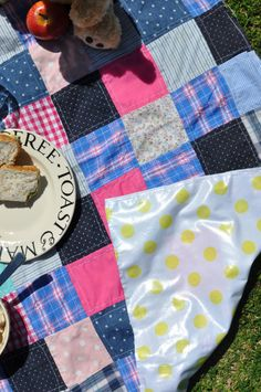 Great idea! PVC/oilcloth backing to make a patchwork quilt a picnic or play mat!! From two plus one