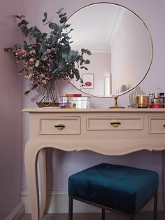 Pink and peach pastel bedroom. Light pink bedroom. Dressing table area. Frenchic paint on dressing table. Blue velvet stool. Large brass trim mirror. Bedroom decor. Bedroom Inspo. Pink Interiors.
