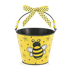 This adorable Little Bee Favor Tin Pail features a yellow and black striped bumblebee on a background of yellow with polka dots and daisies.