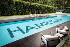 Apartment, Black Wooden Floor White Stainless Steel Leather Armchairs Surrounding Green Plant Backyard Rectangular Swimming Pool Synthetic Grass And Pool Ladder ~ Deluxe Apartment Interior Design with a Modish Car Garage Area