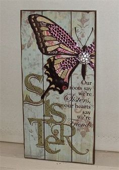 "Sparkling ""Sister"" Wall Plaque.  ;Our roots say we're sisters, our hearts say we're friends'  38cm x 17cm. Embeliished with pink crystals and a crystal cluster on butterfly $18.00  www.thecrystalcave.vpweb.com.au."