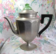 Vintage Coffee Pot Percolator with Green Depression Glass Knob from CurioCabinet, on Etsy...$24.00