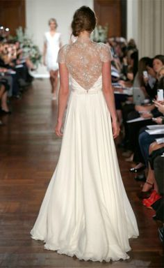 Jenny Packham Wedding Dress. She makes the most beautiful gowns, they are very $$ but good inspiration for detail.