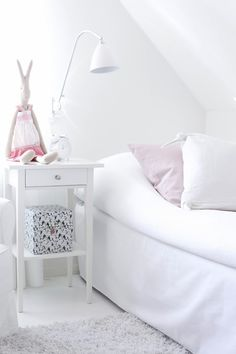 white and pale pink girls room with bunny
