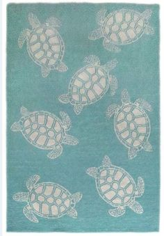 Add a sense of undersea enchantment and tropical color with this new Sea Turtle Aqua Blue Rug!