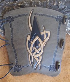 Hand carved leather archery arm guard,bracer,Celtic arrow,smoke blk,LARP,Cosplay by BigfootLeather on Etsy https://www.etsy.com/listing/235634838/hand-carved-leather-archery-arm