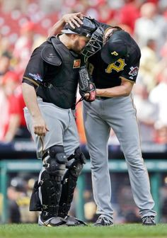 Pittsburgh Pirates relief pitcher Jason Grilli, right, and catcher Russell Martin, left, celebrate after beating the St. Louis Cardinals 7-1 in Game 2. The best-of-five games series is tied 1-1. (Jeff Roberson/AP)