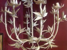 Newspaper decoupaged chandelier - Anthropologie display