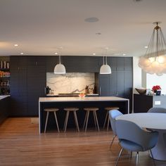 """Art Deco remodel/addition project, kitchen complete! #modmobili #saarinenchair #apparatusstudio #schoolhouseelectric #caesarstone #interiordesign #denverdesign #denverinteriordesign #coloradodesign #alvarezmorris #kitchenremodel #kitchendesign #artdeco #marblebacksplash"" Photo taken by @pamelachelle on Instagram, pinned via the InstaPin iOS App! http://www.instapinapp.com (05/18/2015)"