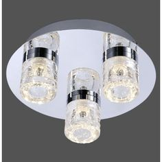 A modern 3 light semi-flush ceiling light in polished chrome with an acrylic shade detail. The light is circular with three open ended cylindrical clear acrylic shades around the inbuilt 6 Watt LEDs. The acrylic has an attractive bubble detail within, which catches the light for an attractive sparkle.   Double insulated, this is safe to use in all homes, including those without an earth cable. It is also IP44 rated so is safe to use in bathroom zones 1, 2 and 3.   We love this modern light…
