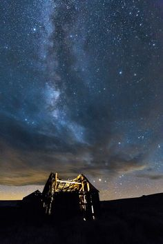 In Bodie State Historical Park, we lit this decaying barn from the inside  for an ethereal effect, with the Milky Way playing peekaboo through the clouds above. www.optimalfocusphotography.com