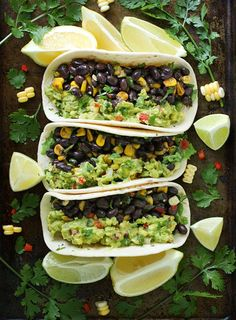 Loaded Guacamole Vegetarian Tacos. Veggie-loaded guacamole tacos with black beans, corn, and peppers. Vegetarian, vegan, and full-on yummy.