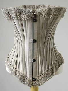 Corset Date: 1895–1905 Culture: probably American Medium: (a) cotton; (b) lace Dimensions: Length at CB: 11 in. (27.9 cm) Credit Line: Gift of Saidie E. Scudder, 1995 Accession Number: 1995.507.7a, b