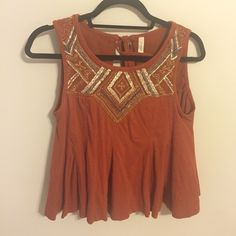 Free people orange tie back tank One of the cutest shirts I've bought. Worn maybe twice! Just don't reach for it as much. Slightly cropped but the detailing is beautiful. Cute with high waisted shorts! Free People Tops Blouses