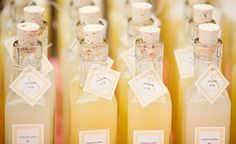 DIY Homemade Limoncello Wedding Favors.....or put different mixed drinks in bottles like these