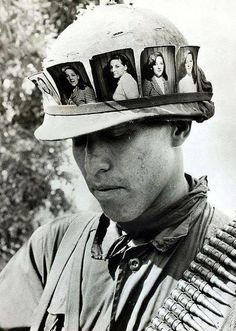 Powerful And Entertaining Historical Photos From The Past This photograph was taken on May 1968 during the Vietnam War. Stationed in Cu Chi, South Vietnam, this American soldier misses his girlfriend so much his helmet band filled with her photograph. Vietnam War Photos, North Vietnam, Vietnam Veterans, Vietnam Protests, Helmet Band, Vietnam History, War Photography, World History, History