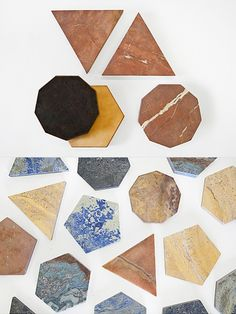 These geometric trivets are from the Fort Standard's new collection, the focal point of which is the beauty of marble and granite surfaces. The trivets are backed with leather for protection and are available in various shapes and colors.