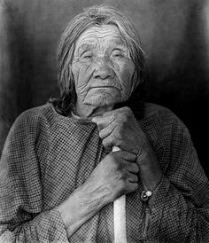 Elderly Pima woman, leaning on staff. Photographed: 1900. - National Anthropological Archives, Smithsonian Institution.