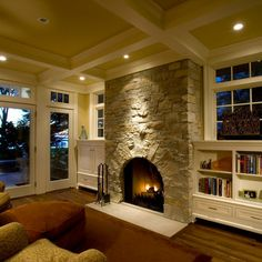 Love the low shelves with the windows with transoms above.  The fireplace needs a mantle though.