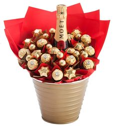 Designed for those who wish to make a statement with their gift giving, this gift lives up to it's reputation. A heavenly bottle of Moet and Chandon sits amidst a sea of delicious Belgian chocolates. Sure to impress, this is a great celebration gift!