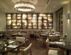 The Botanist, Sloane Square, has an eye-catching wall mural with each rectangular botanical drawing picked out individually using fibre optic lighting by Absolute Action.
