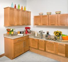 These Dartmouth Honey cabinets from WOLF brighten up the kitchen, don't you think?