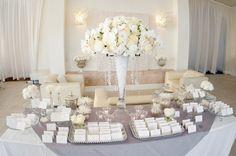 Elegant white orchid topiary wedding centerpiece