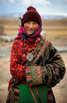 Their clothing is inspirational. I'd love to visit  Tibet and breath the air and be one with such greatness.