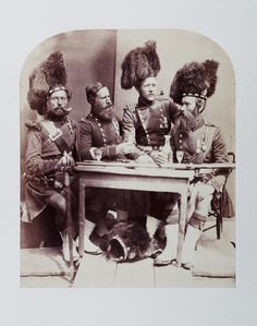 An albumen print photograph entitled 'Highlanders' taken by Joseph Cundall in June 1856.  The photograph was published by the Photographic Exchange Club in 'The Photographic Album of The Year 1857'. This photograph of a group of Highland Scottish soldiers, veterans of the Crimean War, is one of a series of portraits of Crimean War Veterans commissioned by Queen Victoria.