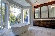 Light-filled master bath with marble floors and high quality finishes | 193 Dianne Avenue, Oakville
