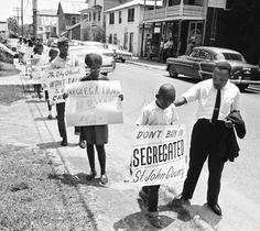 Dr. King with young pickets. June, 1964.