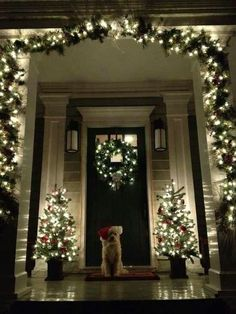 I want a large and deep front porch to decorate like this.  xmas front door decorations