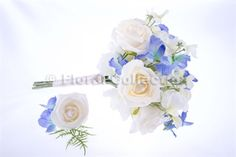Blue Sweet Pea Bridal Bouquet with ivory roses and a diamante heart buckle, Matching Blue Sweet Pea Grooms buttonhole #Groomsbuttonhole #bluewedding