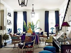 In a 21st-century emulation of eclectic 19th-century interiors, Bilhuber anchored the living room with a center table and deployed a spirited array of period and contemporary furnishings, including a custom-made pale-green Victorian-style chair and a pair of ottomans upholstered in a blue Muriel Brandolini cotton from Holland & Sherry; the curtains are made of a striped linen by C&C Milano.