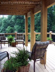 Partially covered deck. Love. Railing that is mixed with the rod iron. Stunning.