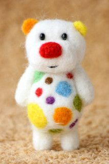 This little multi-color needle felted bear is so funny. It would be fun to make something similar.