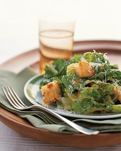 Crisp romaine, pepper-and-butter croutons, and grated Parmesan are tossed with traditional Caesar dressing.