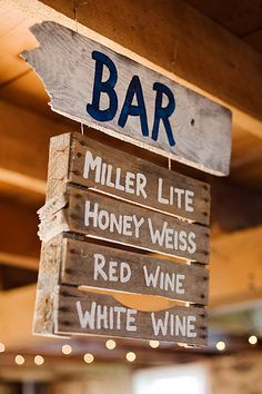 Make the line at the bar go more quickly with a rustic sign that provides all the drink options before guests even get to the bartender. Guests will appreciate not having to look for the bar, too!